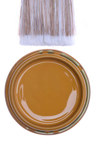 paint can: Top view of brown paint can with brush isolated on white background