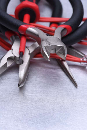 cable cutter: Tools for electrician and cables on gray metal surface