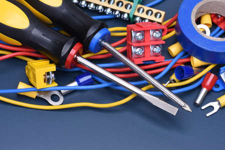 electrical component: Electrical component kit to use in electrical installations on blue metal background