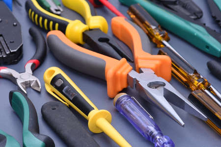 putty knives: Set of tools to electrical installations on metal background