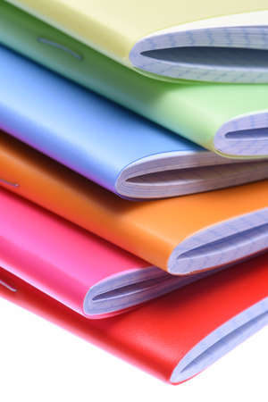 writing materials: Stack of exercise books isolated on white background