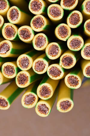 yellow earth: Group of yellow and green earth cable closeup