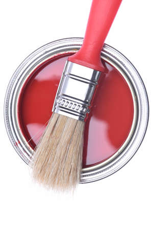 restore: Top view of red paint can with brush isolated on white background Stock Photo