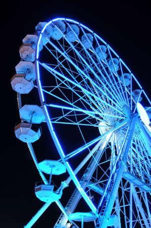 Spinning ferris wheel at night light