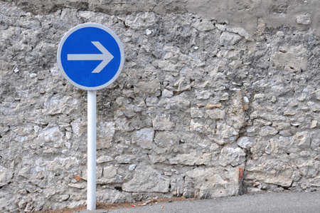 blue arrow: Blue road sign, go to the right Stock Photo