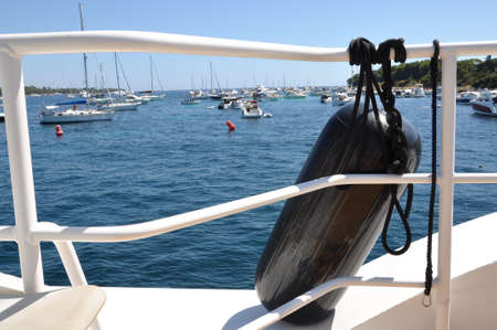 Boat fender on a yacht in the harbor