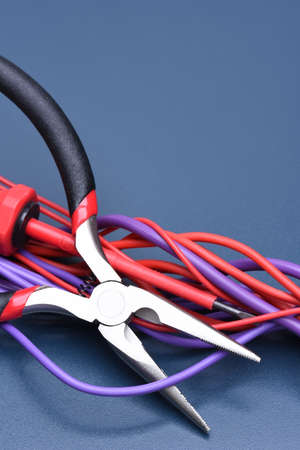 Tools and cable on a metal table, copy space Stock Photo