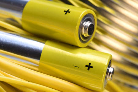 Alkaline battery with electrical cables close up