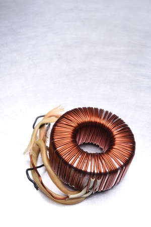 Copper Coil Transformer on Metal Background with Copy Space Stock Photo