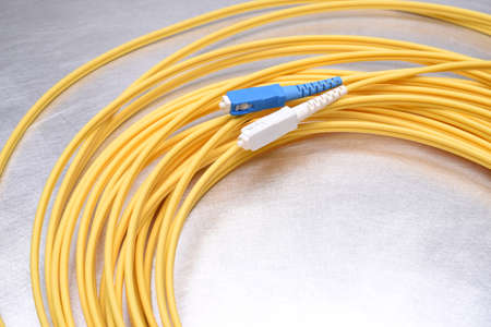 Optical patch cord single mode SC on metal background