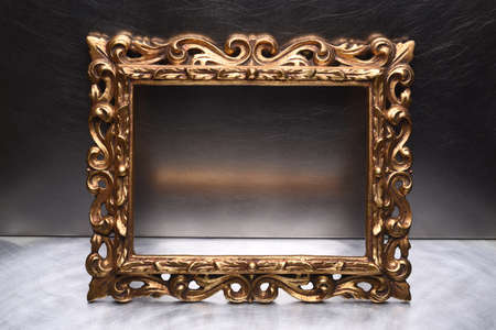 Antique Gold Wooden Frame on Grey Wall Stock Photo