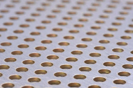 perforated: Aluminum sheet metal perforated with holes texture