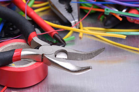 putty knives: Set of electrical tools and components on metal background Stock Photo