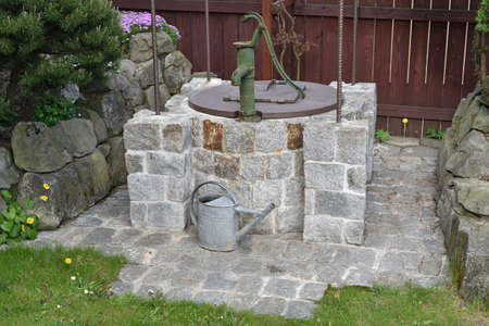 Water Well in the Garden Stock Photo