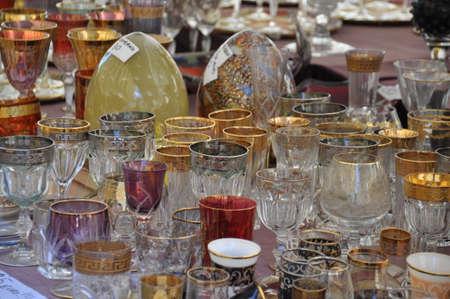 Old carboy damigiana glass for wine on flea market Stock Photo