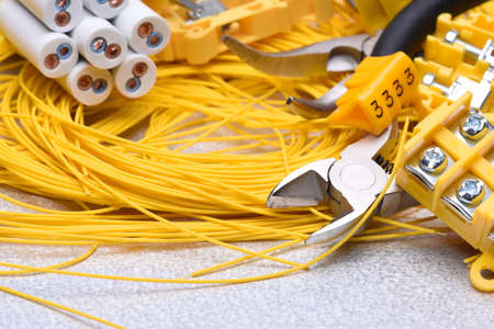 wire cutter: Tools and cables used in electrical home installation, closeup