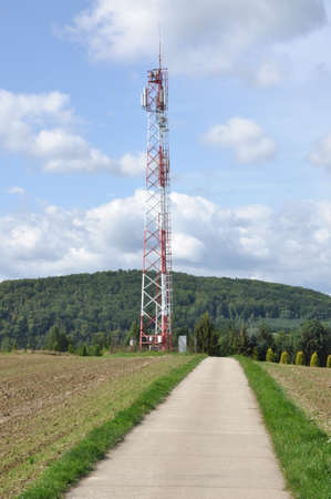 Telecommunication towers on an agricultural field with road