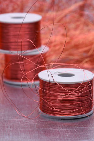 ferrous: Copper electric coil and wire on metal background