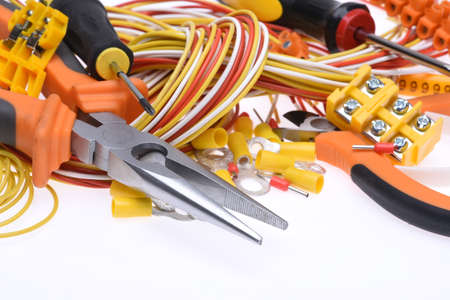 Set of electrical tools and cables on white background