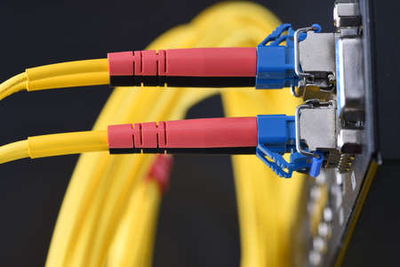 Internet network technology, fiber optic cable connected to switch in data center, close-up Фото со стока - 91427460