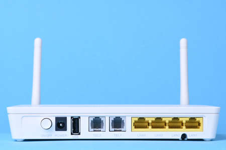 Wireless router network with cable on blue background