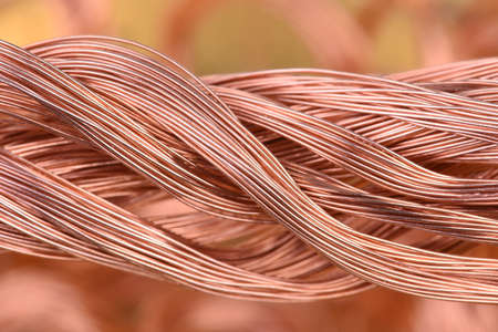 Bundle of copper wire on blurred background Stock Photo