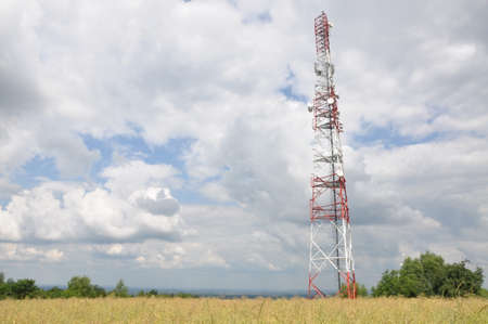 Communication tower on a field