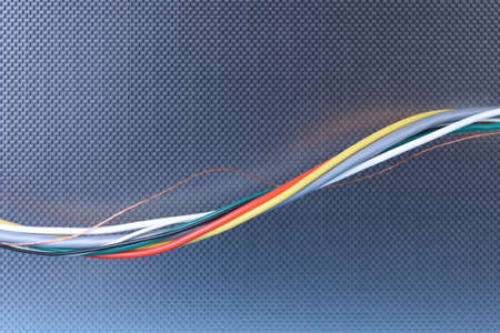 Futuristic flow of data, electric cable on metal background