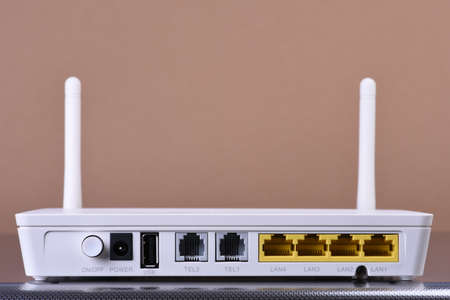 Wireless network router on brown background Reklamní fotografie - 107249145
