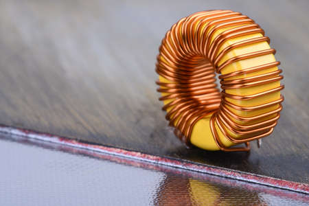 Inductor copper coil on metal background Stock Photo