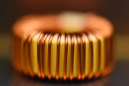 Macro of copper coil with blurred background Stock Photo