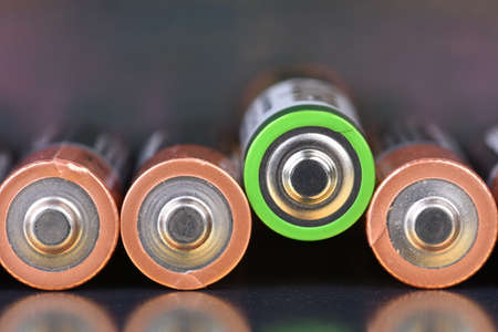 Row alkaline battery aa size on metallic background