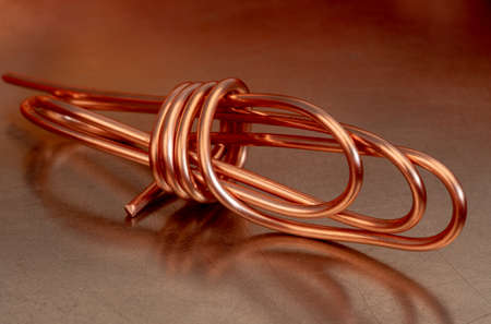 Copper wire on metallic surface Reklamní fotografie