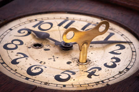 Old antique clock with key winder close-up Stock Photo