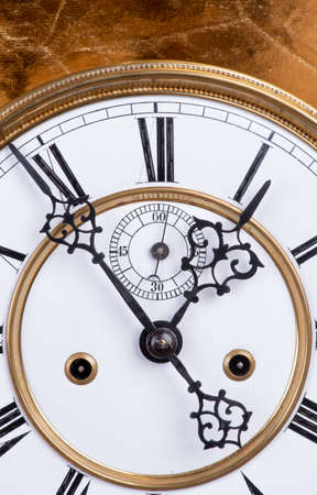 Antique clock with roman numerals about midnight Stock fotó
