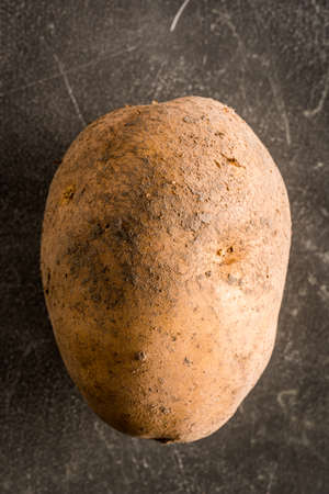 Single Raw Potato Directly Above Close-up
