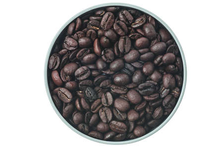 Coffee beans in bowl directly above on white background