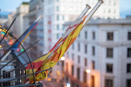 Concept of protest suspended, rolled flag on balcony of building