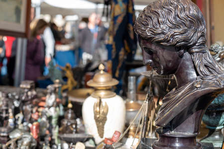 Stone statuette on antique flea market in Barcelona Spain