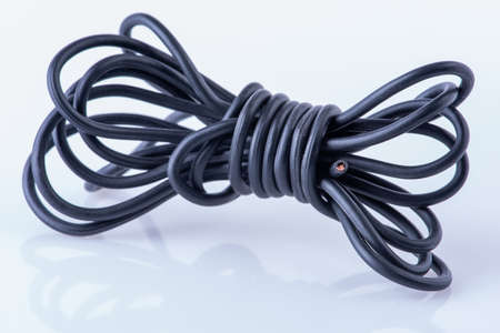 Electrical item rolled electric cable waste close-up