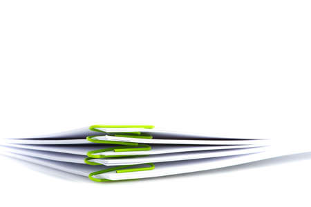 Pile of blank document with paper clip on white background
