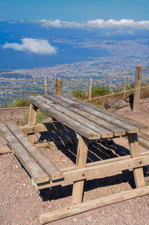 Empty wooden bench on mountain Vesuvio with view on Naples in sunny day Banque d'images