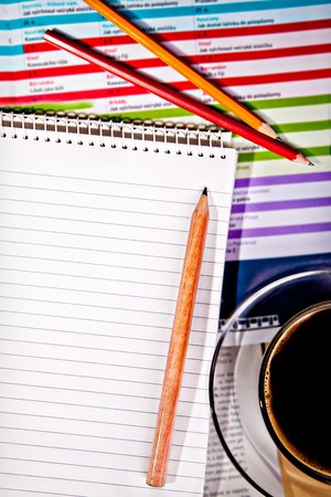 scratchpad: coffee cup and notebook with pencil on desk Stock Photo
