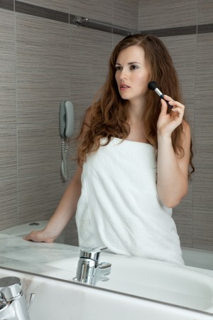 dressed in towel gorgeous woman makeup at modern bathroom Stock Photo - 7658805