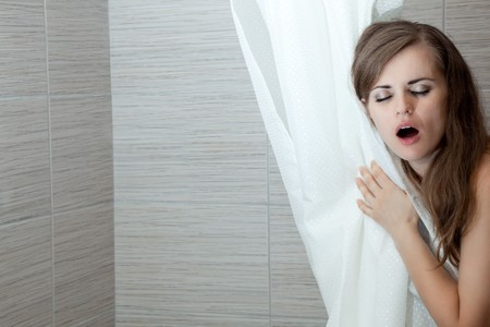 gorgeous woman behind curtain singing at modern bathroom photo