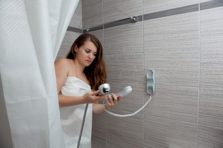 gorgeous woman behind curtain making a call at modern bathroom Stock Photo - 11640395