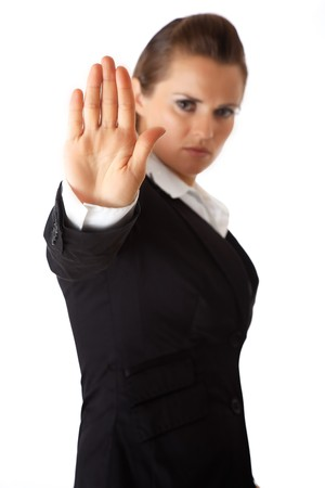 authoritative woman: modern business woman showing stop gesture isolated on white Stock Photo
