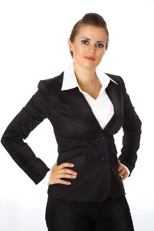 authoritative woman: modern business woman with hands on hips isolated on white