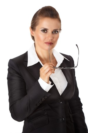 certitude: thoughtful modern business woman holding eyeglasses isolated on white