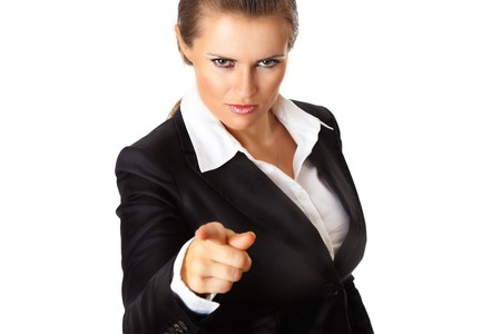 certitude: modern business woman pointing finger at you isolated on white